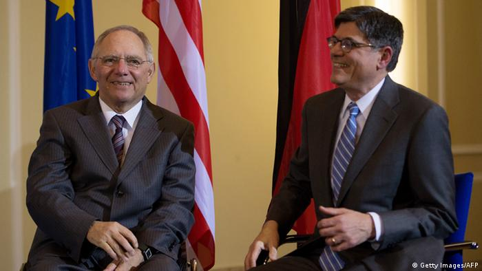 German Finance Minister Wolfgang Schaeuble (L) and US Treasury Secretary Jacob Lew pose for photographers during a press conference on April 9, 2013 in Berlin. Lew urged countries with the capacity to help spur growth, after talks with his German counterpart. AFP PHOTO / JOHANNES EISELE (Photo credit should read JOHANNES EISELE/AFP/Getty Images)