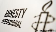 Logo der Organisation Amnesty International, aufgenommen am Freitag (27.05.2011) in Berlin. Foto: Britta Pedersen dpa