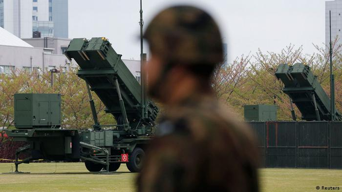 A Japan Self-Defence Forces soldier stands near units of Patriot Advanced Capability-3 (PAC-3) missiles at the Defence Ministry in Tokyo April 10, 2013. REUTERS/Issei Kato (JAPAN - Tags: POLITICS MILITARY)