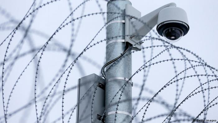 BAUTZEN, GERMANY - DECEMBER 14: A general view of barbed wire fencing and a security camera at the JVA Bautzen prison on December 14, 2012 in Bautzen, Germany. One of the detention houses at the prison has been marked for transformation into a preventive detention facility with construction due for completion in 2013. A new law passed this year clarifies the ability of the state to transfer convicted criminals who have served their sentences yet are still deemed as potentially dangerous to society to preventive detention facilities. (Photo by Joern Haufe/Getty Images)