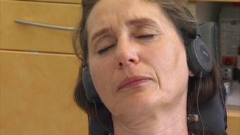 A woman in a hypnotic state, concentrated with her eyes closed