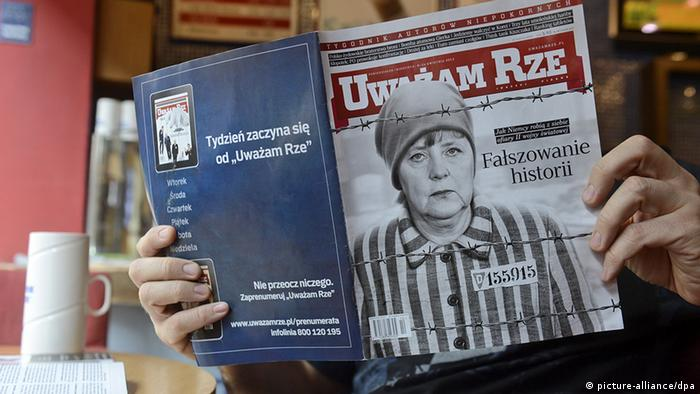 epa03654924 A man reads an 'Uwazam Rze' weekly magazine in Warsaw, Poland, 09 April 2013. Polish right-wing weekly magazine 'Uwazam Rze' on the cover of its 08 April issue shows German Chancellor Angela Merkel behind a barbed wire fence in the clothes of a concentration camp prisoner with signs of the outline of a concentration camp in the background. The magazine accused German TV ZDF: falsification of history in their series about World War Two 'Our Mothers, Our Fathers'. The magazine accused also Germans of making themselves as victims of II World War. EPA/BARTLOMIEJ ZBOROWSKI POLAND OUT