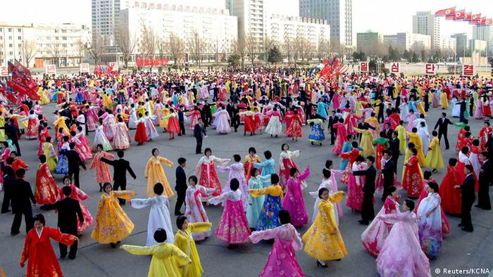 North Koreans dance on a street in Pyongyang as they celebrate the 20th anniversary of late leader Kim Jong-il's election as chairman of North Korea's National Defence Commission, in this picture taken and released by the North's official KCNA news agency on April 9, 2013. REUTERS/KCNA (NORTH KOREA - Tags: ANNIVERSARY MILITARY POLITICS) ATTENTION EDITORS - THIS PICTURE WAS PROVIDED BY A THIRD PARTY. REUTERS IS UNABLE TO INDEPENDENTLY VERIFY THE AUTHENTICITY, CONTENT, LOCATION OR DATE OF THIS IMAGE. THIS PICTURE IS DISTRIBUTED EXACTLY AS RECEIVED BY REUTERS, AS A SERVICE TO CLIENTS. NO THIRD PARTY SALES. NOT FOR USE BY REUTERS THIRD PARTY DISTRIBUTORS