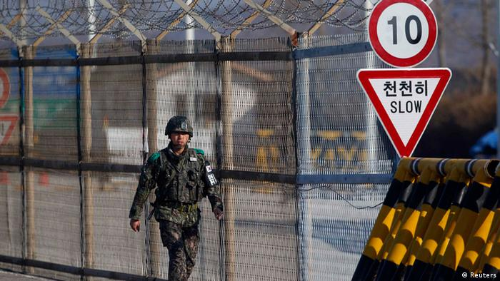 A South Korean soldier patrols along a barbed-wire fence at a checkpoint on the Grand Unification Bridge, which leads to the demilitarized zone separating North Korea from South Korea, in Paju, north of Seoul April 10, 2013. South Korea has raised its surveillance of North Korea after the reclusive state moved one or more long-range missiles in readiness for a possible launch, Yonhap news agency reported on Wednesday. REUTERS/Kim Hong-Ji (SOUTH KOREA - Tags: POLITICS MILITARY)