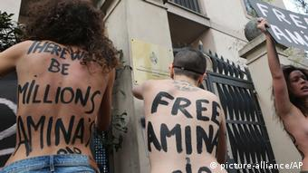 In this April 4, 2013 file photo, FEMEN activists protest in front of the Tunisian Consulate in Milan, Thursday, April 4, 2013. The radical feminists, calling for more sexual freedom for Arab women, were protesting in support of a young Tunisian woman who received online death threats from ultraconservative Muslims after posting topless photos of herself online. Women's rights activists across the middle east fear the topless protests may hurt their cause more than help it. (AP Photo/Antonio Calanni)