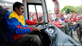Venezuelan acting president Nicolas Maduro drives a bus on his way to a campaign rally in the state of Barinas, Venezuela on March 30, 2013, ahead of the presidential election on April 14. AFP PHOTO/JUAN BARRETO (Photo credit should read JUAN BARRETO/AFP/Getty Images)
