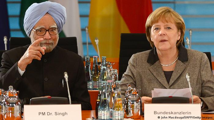 Indian Prime Minister Manmohan Singh (L) and German Chancellor Angela Merkel pose before leading the Indo-German intergovernmental consultations with cabinet and delegation members at the Chancellery on April 11, 2013 in Berlin. AFP PHOTO / JOHN MACDOUGALL (Photo credit should read JOHN MACDOUGALL/AFP/Getty Images)