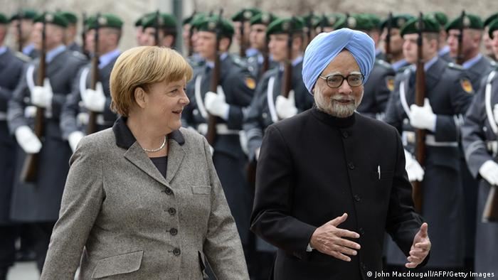 Indian Prime Minister Manmohan Singh (R) and German Chancellor Angela Merkel inspect a military honor guard during a welcoming ceremony at the Chancellery on April 11, 2013 in Berlin. (Photo: AFP/Getty Images)