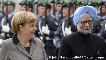 Indian Prime Minister Manmohan Singh (R) and German Chancellor Angela Merkel inspect a military honor guard during a welcoming ceremony at the Chancellery on April 11, 2013 in Berlin. Singh and key cabinet ministers meet for their second Indo-German intergovernmental consultations in Berlin. AFP PHOTO / JOHN MACDOUGALL (Photo credit should read JOHN MACDOUGALL/AFP/Getty Images)