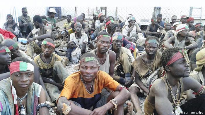 ©Delphin Bateko/PANAPRESS/MAXPPP - 23/03/2013 ; Kinshasa ; DR Congo - LUMUMBASHI - MARCH 23: Some members of the Mai-Mai rebel group called 'Bakata Katanga' who have taken refuge in the premises of the United Nations Stabilisation Mission in DR Congo (MONUSCO) after they entered the city opening fire against government troops, causing many casualties, on March 23, 2013 in Lumumbshi, DR Congo. (Photo Delphin Bateko/ Panapress) - LUMUMBASHI - 23 MARS: Des miliciens du groupe Mai-Mai denomme Bakata Katanga qui se sont refugies au camp de la Mission des Nations Unies pour la stabilisation en RD Congo (Monusco) apres avoir fait irription dans la ville et seme une panique generale par les des tirs echanges avec les militaires congolais, causant plusieurs morts. Lumumbashi, DR Congo, 23 mars. (Photo Delphin Bateko/ Panapress)
