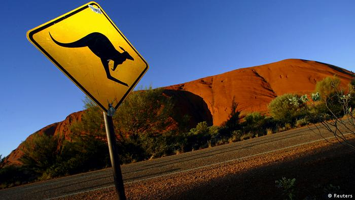 A road sign near Ayers Rock southwest of the central Australian town of Alice Springs warns drivers of the dangers of kangaroos crossing the road (Photo: REUTERS/Tim Wimborne)