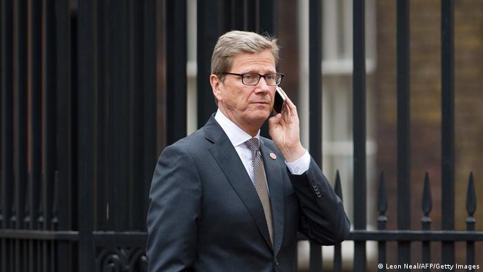German Foreign Minister Guido Westerwelle talks on a mobile phone as he walks outside Lancaster House during a break in the G8 Foreign Ministers meeting in central London on April 11, 2013. G8 foreign ministers including US Secretary of State John Kerry held a second day of talks in London with the crisis on the Korean peninsula and the Syrian conflict topping the agenda. AFP PHOTO / LEON NEAL (Photo credit should read LEON NEAL/AFP/Getty Images)