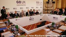 G8 Foreign Ministers and members of their teams, Russian Foreign Minister Segei Lavrov (2L), British Foreign Secretary William Hague (C), US Secretary of State John Kerry (5L), French Foreign Minister Laurent Fabius (2R) and Canadian Foreign Minister John Baird (R) attend the opening session of the G8 Foreign Ministers meeting at Lancaster House in London on April 11, 2013. G8 Foreign Ministers will be discussing the situation in Syria, the spiralling North Korean nuclear crisis and Iran's atomic ambitions at their meeting, a prelude to the annual Group of Eight leaders' summit later this year in Northern Ireland. AFP PHOTO / POOL / PETER MACDIARMID (Photo credit should read PETER MACDIARMID/AFP/Getty Images)