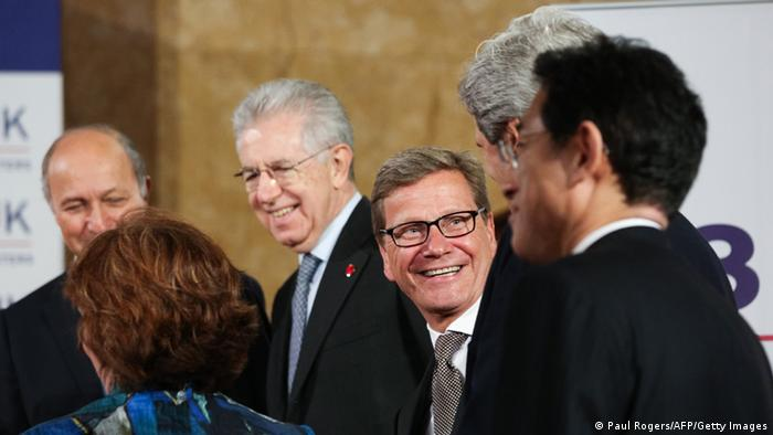 German Foreign Minister Guido Westerwelle (C) smiles during the opening session of the G8 Foreign Ministers meeting at Lancaster House in London on April 11, 2013. G8 Foreign Ministers will be discussing the situation in Syria, the spiralling North Korean nuclear crisis and Iran's atomic ambitions at their meeting, a prelude to the annual Group of Eight leaders' summit later this year in Northern Ireland. AFP PHOTO / POOL / PAUL ROGERS (Photo credit should read PAUL ROGERS/AFP/Getty Images)