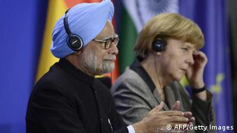 Indian Prime Minister Manmohan Singh and German Chancellor Angela Merkel give a press conference at the Chancellery on April 11, 2013 in Berlin. Singh and key cabinet ministers meet for their second Indo-German intergovernmental consultations in Berlin. Ministers from both sides were to sign memorandums of understanding on cooperation in fields including renewable energies and power grids, agriculture, university cooperation, and teaching the German language in India. AFP PHOTO / JOHN MACDOUGALL (Photo credit should read JOHN MACDOUGALL/AFP/Getty Images)