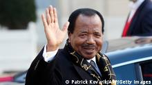 Cameroon president Paul Biya waves as he leaves the Elysee Palace following a meeting with French president at on January 30, 2013 in Paris. Biya is in Paris on a working visit to meet French business leaders. AFP PHOTO / PATRICK KOVARIK (Photo credit should read PATRICK KOVARIK/AFP/Getty Images)