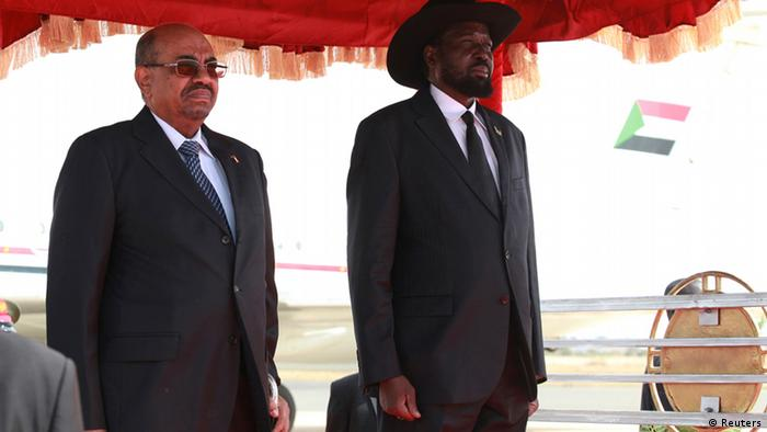 Sudan's President Omar Hassan al-Bashir (L) and his South Sudan counterpart Salva Kiir listen to their national anthems upon his arrival at the Juba Airport in South Sudan April 12, 2013. Bashir visits South Sudan on Friday for the first time since Africa's once-largest country split in 2011, raising hope the two long-time adversaries will take steps to establish peaceful co-existence. REUTERS/Andreea Campeanu (SOUTH SUDAN - Tags: POLITICS)