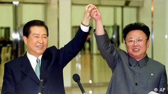 * FILE ** North Korean leader Kim Jong Il, right, and South Korean President Kim Dae-jung raise their arms together before signing a joint declaration at the end of the second day of a three day summit in Pyongyang in this June 14, 2000 file photo. The leaders of North and South Korea will hold their second-ever summit later this month in Pyongyang, Yonhap news agency reported Wednesday, Aug. 8, 2007, reprising the historic 2000 meeting that launched unprecedented reconciliation between the two longtime foes. In June 2000, Kim Jong Il met then-South Korean President Kim Dae-jung, also in Pyongyang.(AP Photo/Yonhap, Pool)