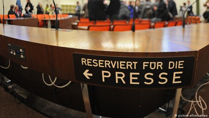 A photo of the Munich court, with a prominent sign saying reserved for the press in German (reserviert für Presse) visible. (Photo: dpa)