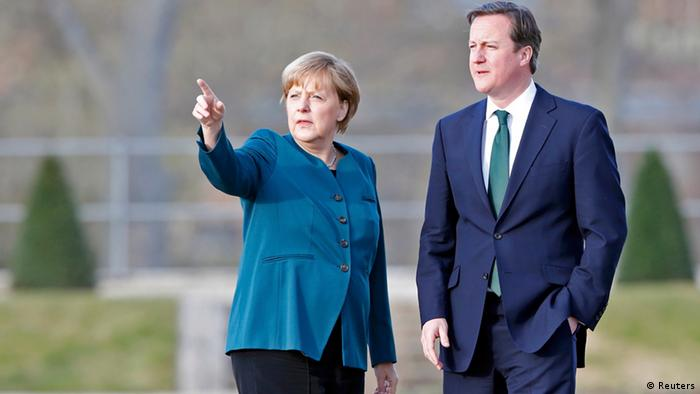 German Chancellor Angela Merkel and Britain's Prime Minister David Cameron look on as they stroll inside the yard of the government's guest house Schloss Meseberg, 70 km (44 miles) north of Berlin April 12, 2013. REUTERS/Fabrizio Bensch (GERMANY - Tags: POLITICS)