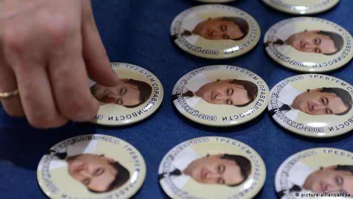 ITAR-TASS: MOSCOW, RUSSIA. APRIL 8, 2013. Pins bearing portraits of Sergei Magnitsky, an accountant and auditor at the British investment company Hermitage Capital Management. Sergei Magnitsky died in custody in November 2009 at the age of 37. The Moscow Sakharov Cen¬ter marks the 41st birth¬day of the late lawyer. (Photo ITAR-TASS/ Stanislav Krasilnikov)