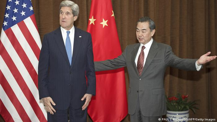US Secretary of State John Kerry is greeted by Chinese Foreign Minister Wang Yi (R) in Beijing on April 13, 2013, to attending meetings with officials. Kerry arrived in Beijing to seek China's help to rein in a belligerent North Korea and provide a foundation for Seoul to lower soaring tensions with Pyongyang. AFP PHOTO / POOL / Paul J. Richards (Photo credit should read PAUL J. RICHARDS/AFP/Getty Images)