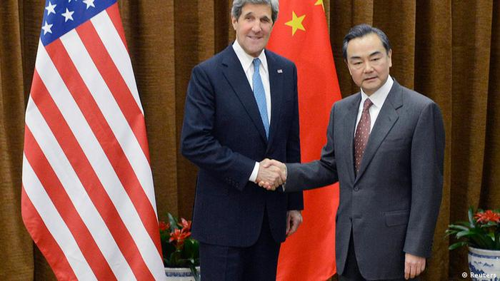 U.S. Secretary of State John Kerry (L) shakes hands with China's Foreign minister Wang Yi before a meeting at the Chinese Foreign Ministry in Beijing April 13, 2013. REUTERS/Yoshuke Mizuno/Pool (CHINA - Tags: POLITICS)