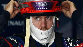 Red Bull Formula One driver Sebastian Vettel of Germany removes his helmet after the third practice session of the Chinese F1 Grand Prix at the Shanghai International Circuit, April 13, 2013. REUTERS/Aly Song (CHINA - Tags: SPORT MOTORSPORT F1)