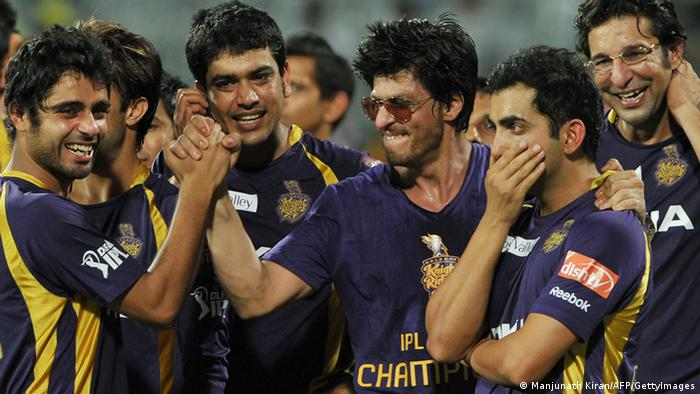 Kolkata Knight Riders owner and Bollywood actor Shah Rukh Khan (3rd R) celebrates with his teammates after they won the DLF IPL Twenty20 Champions Trophy in a final match against Chennai Super Kings at the M.A. Chidambaram Stadium in Chennai on May 27, 2012 (Photo: Manjunath Kiran/AFP/GettyImages)