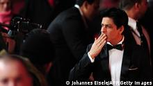 Indian actor Shah Rukh Khan arrives for the premiere of the film 'Don - The King Is Back' in Berlin on February 11, 2012. The 62nd Berlinale, the first major European film festival of the year, kicked off on February 9, 2012, with 23 productions screening in the main showcase. AFP PHOTO / JOHANNES EISELE (Photo credit should read JOHANNES EISELE/AFP/Getty Images)