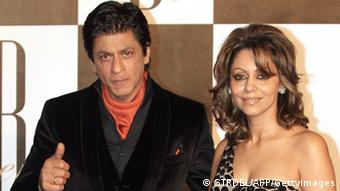 Indian Bollywood actor Shah Rukh Khan poses with his wife Gauri (STRDEL/AFP/GettyImages)
