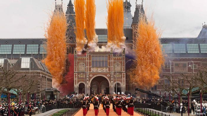 Queen Beatrix of the Netherlands (not visible) ignites fireworks at the Rijksmuseum in Amsterdam April 13, 2013. Thousands of people gathered outside Amsterdam's Rijksmuseum, home to Rembrandt van Rijn's The Night Watch and other Dutch masterpieces, as Queen Beatrix declared the national museum open on Saturday after a decade-long renovation. REUTERS/Michael Kooren (NETHERLANDS - Tags: SOCIETY TRAVEL)