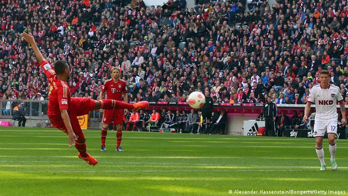 MUNICH, GERMANY - APRIL 13: Jerome Boateng (L) of Muenchen scores the opening goal during the Bundesliga match between FC Bayern Muenchen and 1. FC Nuernberg at Allianz Arena on April 13, 2013 in Munich, Germany. (Photo by Alexander Hassenstein/Bongarts/Getty Images)