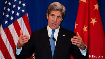 U.S. Secretary of State John Kerry attends a news conference in Beijing April 13, 2013. China and the United States will set up a working group on cyber-security, Kerry said on Saturday, as the two sides moved to ease months of tensions and mutual accusations of hacking and Internet theft. REUTERS/Paul J. Richards/Pool (CHINA - Tags: POLITICS SCIENCE TECHNOLOGY)