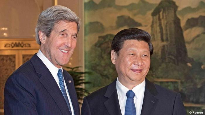 US Secretary of State John Kerry (L) is greeted by Chinese President Xi Jinping shortly before their private meeting at the Great Hall of the People in Beijing April 13, 2013 (Photo: REUTERS/Paul J. Richards/Pool)