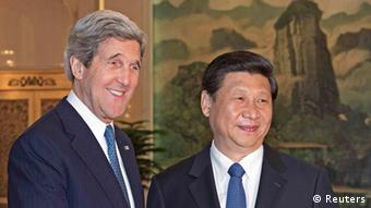 U.S. Secretary of State John Kerry (L) is greeted by Chinese President Xi Jinping shortly before their private meeting at the Great Hall of the People in Beijing April 13, 2013. Kerry met China's top leaders on Saturday in a bid to persuade them to exert pressure on North Korea to scale back its belligerent rhetoric and, eventually, return to nuclear talks. REUTERS/Paul J. Richards/Pool (CHINA - Tags: POLITICS)