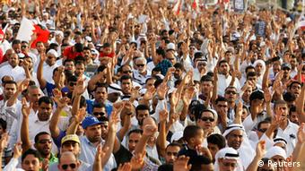 Protesters raise hands and shout anti-government slogans as they participate in an anti-government rally organised by Bahrain's main opposition group Al Wefaq, in the village of Salmabad south of Manama, April 12, 2013. (Photo: REUTERS/Hamad I Mohammed)