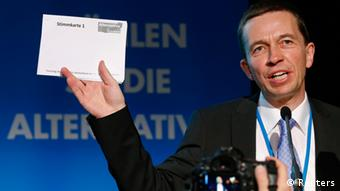 Bernd Lucke, professor of macroeconomics and co-founder of Germany's anti-euro party Alternative fuer Deutschland (Alternative for Germany), holds up a ballot paper as he addresses delegates during the first party congress in Berlin April 14, 2013. The party is holding its first general meeting and plans to get listed for Germany's upcoming general elections in September. REUTERS/Fabrizio Bensch (GERMANY - Tags: BUSINESS POLITICS)