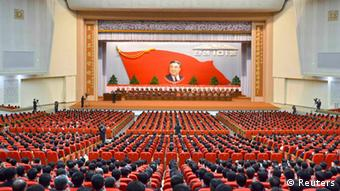 Attendees applaud during a central report meeting to celebrate the 101st birth anniversary of North Korean founder Kim Il-Sung, at the April 25 Culture Hall in Pyongyang, in this photo distributed by North Korea's Korean Central News Agency (KCNA) on April 14, 2013. (NORTH KOREA - Tags: POLITICS ANNIVERSARY) ATTENTION EDITORS - THIS PICTURE WAS PROVIDED BY A THIRD PARTY. REUTERS IS UNABLE TO INDEPENDENTLY VERIFY THE AUTHENTICITY, CONTENT, LOCATION OR DATE OF THIS IMAGE. THIS PICTURE IS DISTRIBUTED EXACTLY AS RECEIVED BY REUTERS, AS A SERVICE TO CLIENTS. NO THIRD PARTY SALES. NOT FOR USE BY REUTERS THIRD PARTY DISTRIBUTORS. QUALITY FROM SOURCE