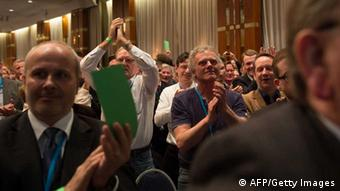 Members of Germany's anti-euro party AfD 'Alternative fuer Deutschland' (Alternative for Germany) applaud during the first party meeting of Germany's anti-euro party AfD 'Alternative fuer Deutschland' (Alternative for Germany) on April 14, 2013 in Berlin. AFP PHOTO / JOHANNES EISELE (Photo credit should read JOHANNES EISELE/AFP/Getty Images)