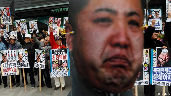 Anti-North Korean protesters from conservative, right-wing and pro-U.S. civic groups, chant slogans near an effigy of North Korean leader Kim Jong-un during a protest in central Seoul April 15, 2013. North Korea celebrated the 101st anniversary of its founder's birth with flowers on Monday, although there was no sign of tension easing as South Korea warned that the North's survival could be in question without change and development. REUTERS/Lee Jae-Won (SOUTH KOREA - Tags: CIVIL UNREST MILITARY POLITICS)