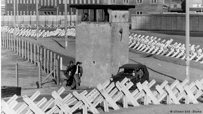 A black-and-white photograph shows a prison compound.