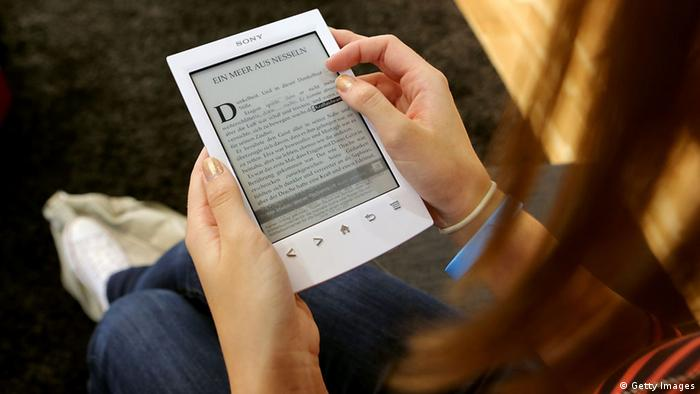 A young girl looks at a Sony e-book at the Frankfurt Book Fair on October 10, 2012 in Frankfurt, Germany. (Photo: Hannelore Foerster/Getty Images)