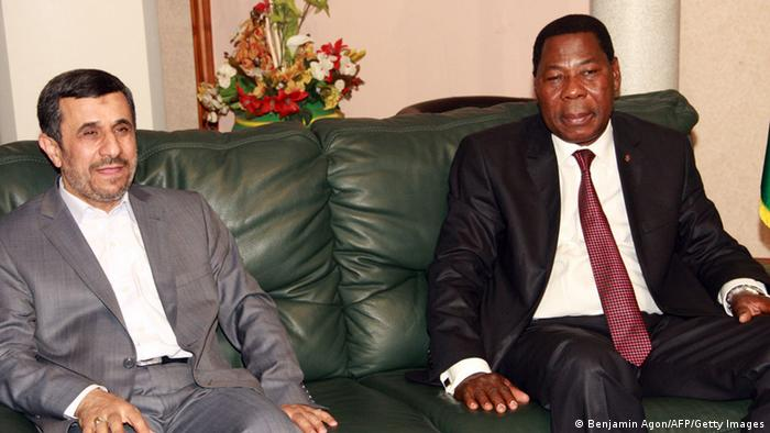 Iranian President Mahmoud Ahmadinejad sits next to Benin's President Thomas Boni Yayi (R) upon his arrival in Cotonou on April 14, 2013. Iranian President Mahmoud Ahmadinejad arrived in Benin on the first stop of a west African tour that will also take him to Niger -- the world's fourth-largest uranium producer -- and to Ghana. AFP PHOTO / BENJAMIN AGON (Photo credit should read Benjamin Agon/AFP/Getty Images)