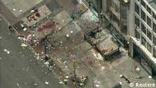 Still image taken from video courtesy of NBC shows the scene of an explosion at the Boston Marathon, April 15, 2013. Two explosions struck the marathon as runners crossed the finish line on Monday, witnesses said, injuring an unknown number of people on what is ordinarily a festive day in the city. REUTERS/NBC/Handout (UNITED STATES - Tags: CIVIL UNREST SPORT ATHLETICS) FOR EDITORIAL USE ONLY. NOT FOR SALE FOR MARKETING OR ADVERTISING CAMPAIGNS. THIS IMAGE HAS BEEN SUPPLIED BY A THIRD PARTY. IT IS DISTRIBUTED, EXACTLY AS RECEIVED BY REUTERS, AS A SERVICE TO CLIENTS. NO ARCHIVES. UNITED STATES OUT. NO COMMERCIAL OR EDITORIAL SALES IN UNITED STATES. NO ONLINE USE. NOT FOR SALE FOR INTERNET DISPLAY
