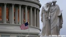 WASHINGTON, DC - APRIL 15: A U.S. flag flies at half staff on the U.S. Capitol April 15, 2013 on Capitol Hill in Washington, DC. Speaker of the House Rep. John Boehner (R-OH) has ordered to lower the flags after two people were confirmed dead and at least 100 injured after at least two explosions went off near the finish line of the Boston Marathon. (Photo by Alex Wong/Getty Images)