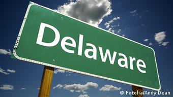 Delaware Road Sign with dramatic clouds and sky. Andy Dean - Fotolia. 8596241 delaware; delaware flag; america; american flag; american states; flag; pole; clipping path; national flag; country; brandish; national colors; unity; 3d; render; patriotism; freedom; waving; sky; cloudscape; clouds; togetherness; wind; coat of arms; isolated