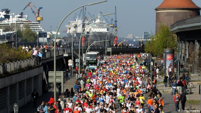 HAMBURG, GERMANY - APRIL 25: A part of about 20,0000 participants run at the 'Landungsbruecken' during the Moebel Kraft Marathon on April 25, 2010 in Hamburg, Germany. (Photo by Joern Pollex/Bongarts/Getty Images)
