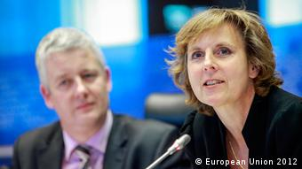 Connie Hedegaard speaks with Matthias Groote sitting in the background (c) European Union 2012