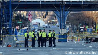 Police officers stand near the finish line of the Boston Marathon as an investigation continues into dual bombings at the site, in Boston, USA, 16 April 2013. Three people were killed and over 100 were injured when two bombs exploded on 15 April 2013 at the finish line of the marathon. EPA/JUSTIN LANE